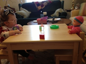 Haddie Joy enjoying her two favorite presents; her baby and table!